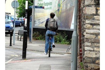 Cyclist riding on the pavement